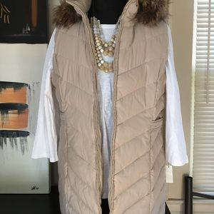 Winter puffer vest with faux fur hood
